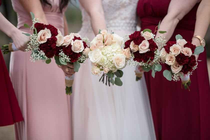 women holding bouquet of flowers